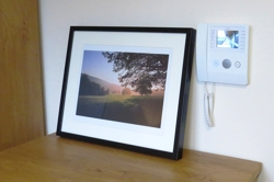 Photograph showing the intercom system at Heatherstones Court together with a decorative photograph
