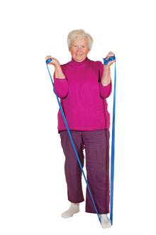 Older lady exercising with stretch bands