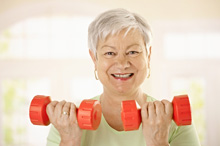 Older lady exercising with dumbells