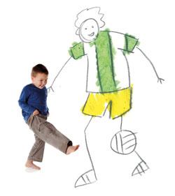 image of a boy kicking