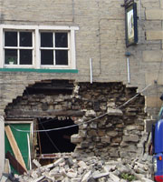 Business premises with collapsed wall.
