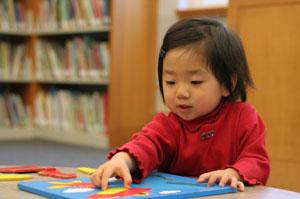 Child doing jigsaw
