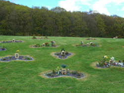 Small garden memorial plaques at Park Wood Crematorium